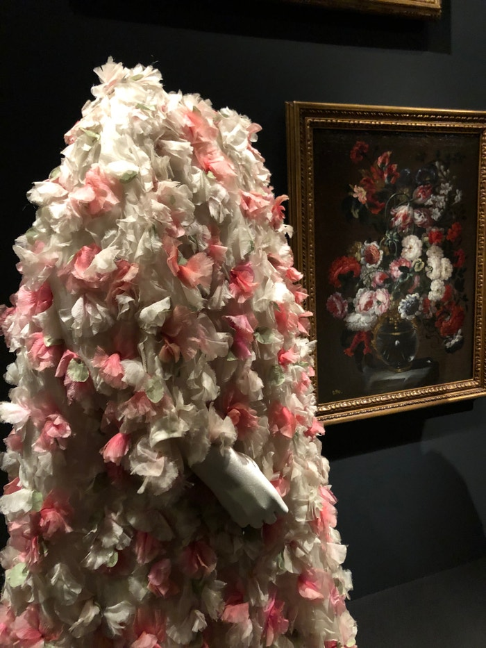 A Balenciaga organza evening coat with floral applications (1964) set against the still-life by Gabriel de la Corte, 'Flowers in a vase' (second-half of the 17th century)