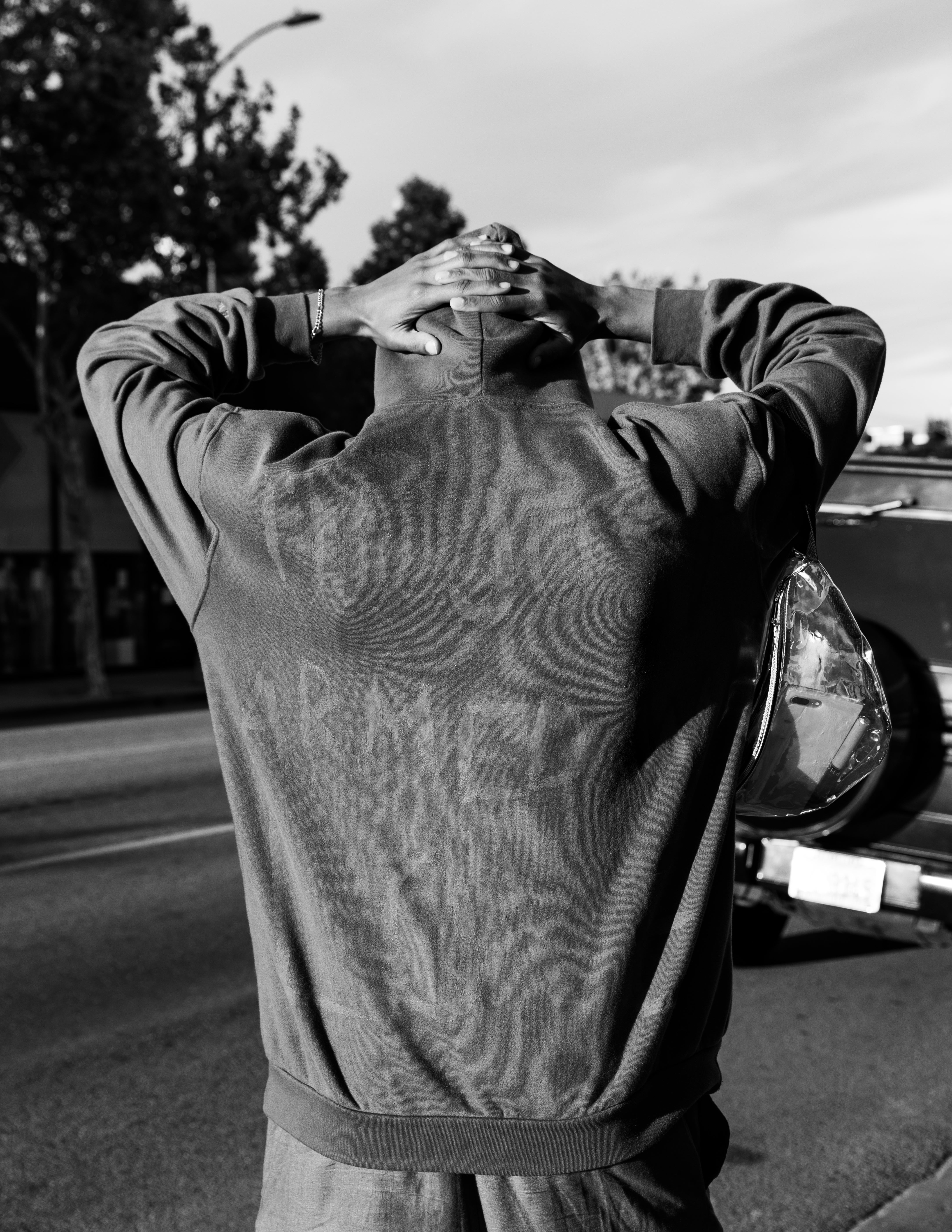 "30 May 2020. A peaceful protester wearing a jumper saying, ""I'm just armed with love"" at the Black Lives Matter protest, Los Angeles. Autor: Alexis Hunley"