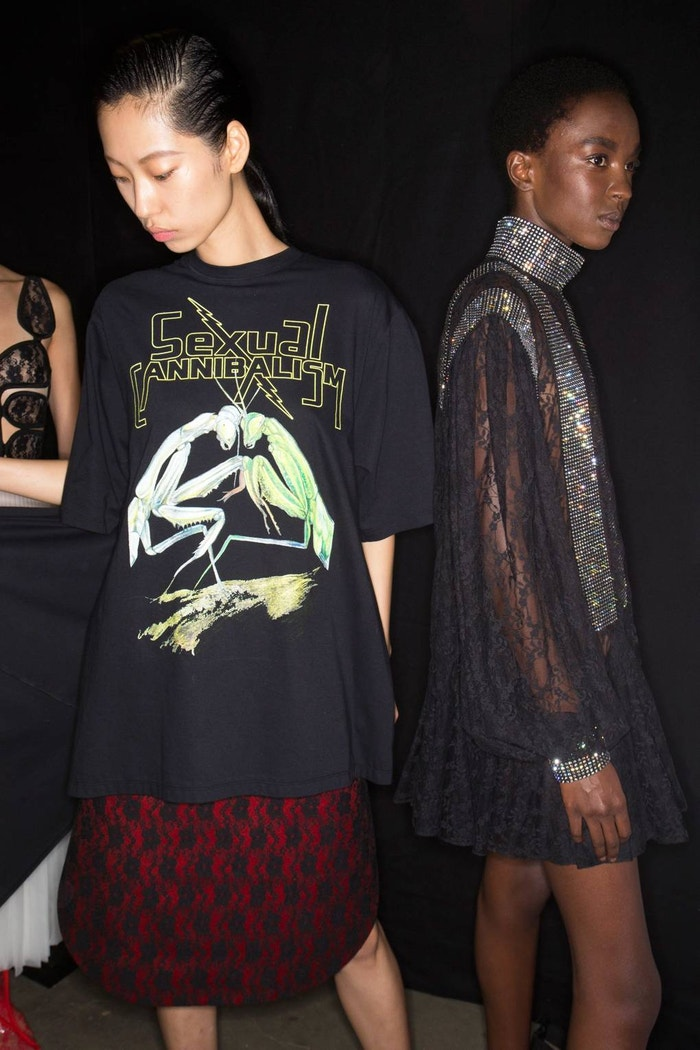 "Backstage at Christopher Kane Spring/Summer 2019. Inspired by nature documentaries of predatory insects, Kane's slogan Ts read ""Sexual cannibalism"""