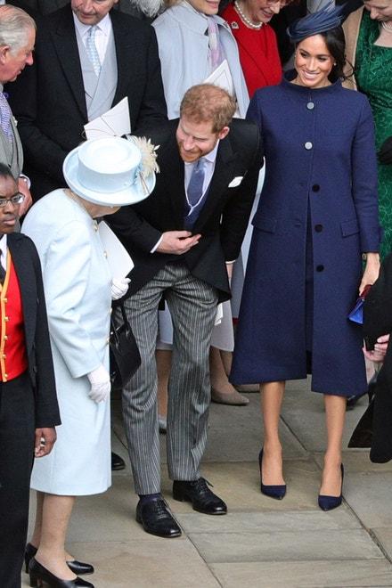 Královna Alžběta II. s vévodou a vévodkyní ze Sussexu na svatbě princezny Eugenie, Windsor, říjen 2018