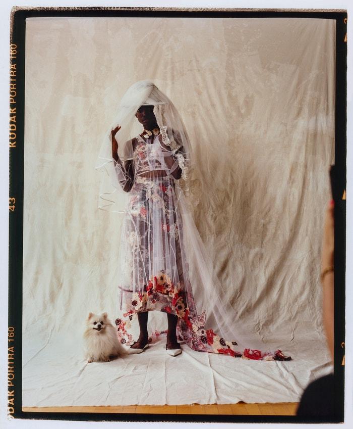 Dress, Tolu Coker; veils, The Wedding Club; hat, Maison Michel; shoes, Jimmy Choo;  necklace, Ami Doshi Shah (sold at Koibird).