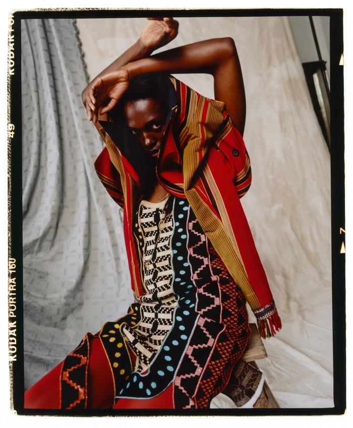 Blazer, Gloria Wavamunno; dress, Maxhosa (sold at Koibird); tights, Wolford; boots, Stella McCartney; necklaces, Vintage.