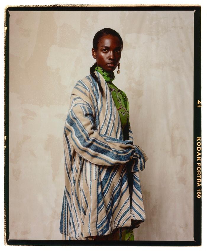 Dress, Lisa Folawiyo (sold at Koibird); blazer, Gloria Wavamunno; ring, earrings, all Vintage.
