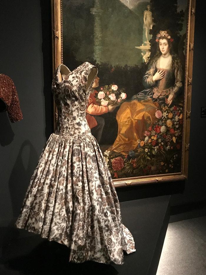 A Balenciaga silk Ikat-weave evening-gown (1958) displayed next to Juan van de Hamen y Leon's 'An Offering to Flora' (1627)