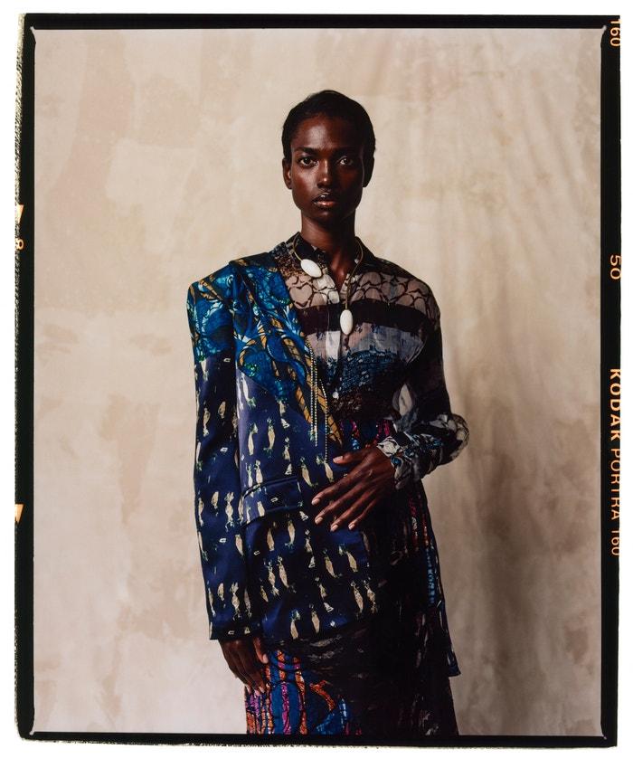 Blazer, blouse, skirt, Lisa Folawiyo (sold at Koibird); necklace, Ami Doshi Shah (sold at Koibird); shoes, Jimmy Choo.