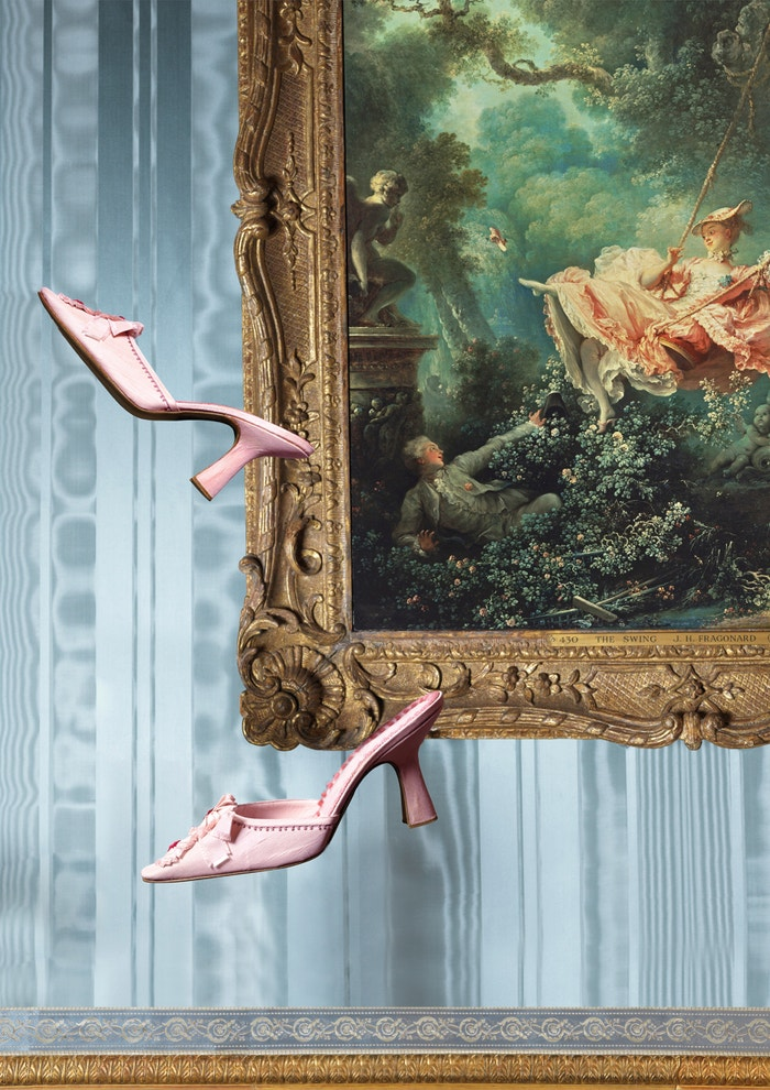 A pairing of shoes and Jean-Honoré Fragonard's oil painting 'The Swing' from the exhibition An Enquiring Mind: Manolo Blahnik at the Wallace Collection