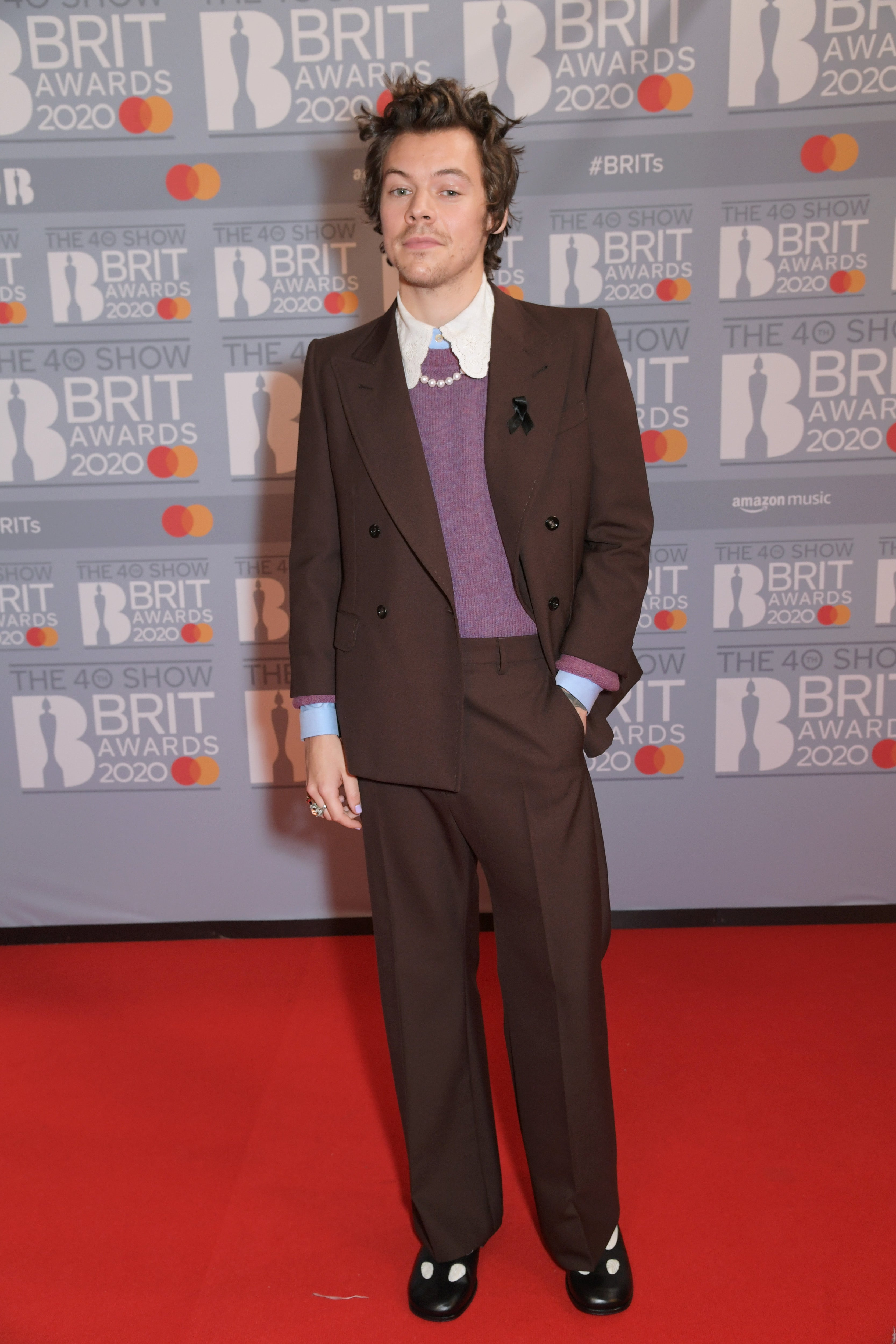 Harry Styles v Gucci Autor: David M. Benett/Dave Benett/Getty Images