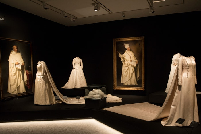 Far left, a fur-trimmed wedding dress that Balenciaga made for Queen Fabiola of Belgium in 1960, set against portraits by Francisco Zurbarán (1628-34)