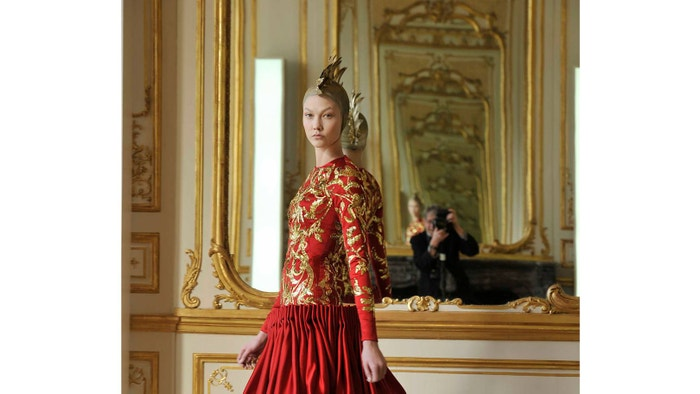 A new exhibition at the Bowes Museum celebrates the work of fashion runway photographer Chris Moore, whose reflection is captured here at the Alexander McQueen Autumn/Winter 2010 show. The photographer and designer had a close working relationship and Moore was the only photographer allowed to photograph the designer's collection after his death
